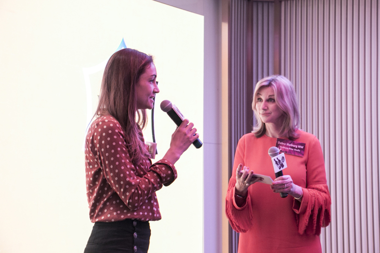 Gaëlle Goossens with Debra Meiburg on stage at WoW (courtesy Meiburg Wine Media)