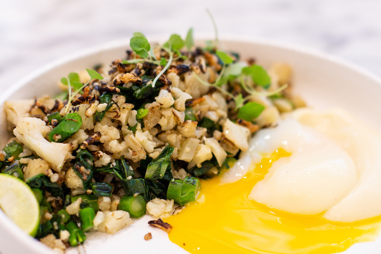 Cauliflower and charred kale with rice puff and egg