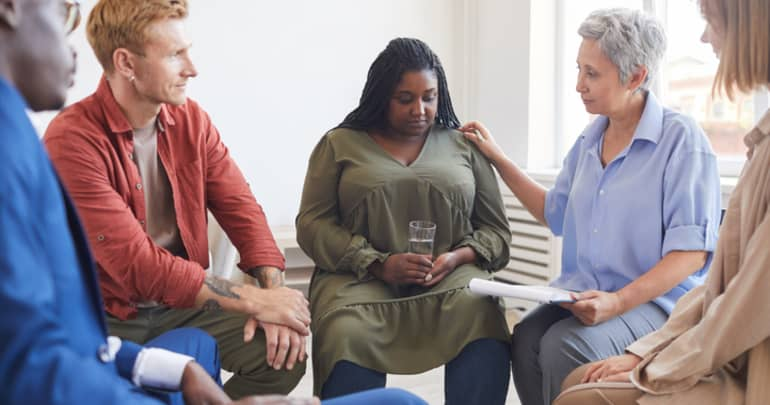 African woman in group therapy session