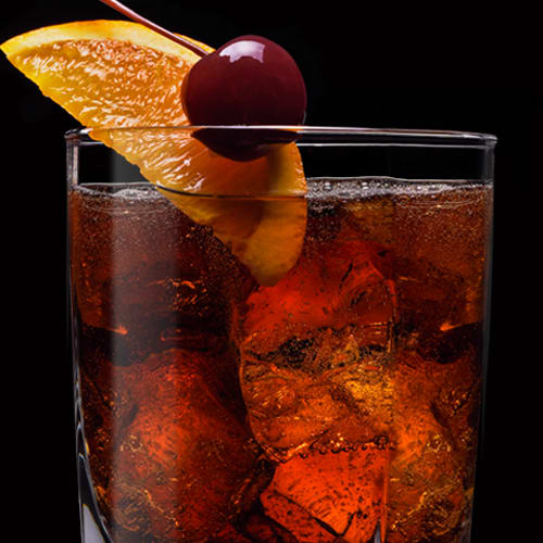 Godfather Number 7 Cocktail served with orange slice and cherry