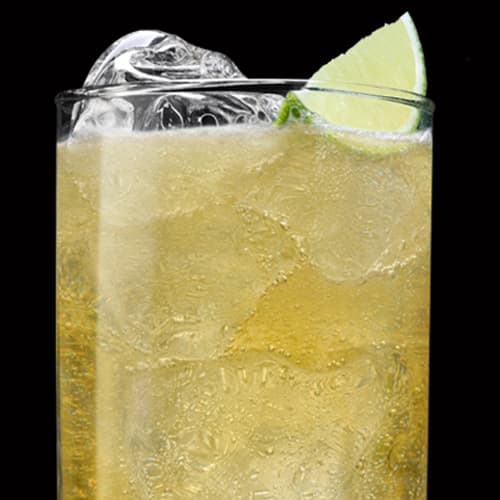 Jack and Ginger Cocktail served with lime wedge
