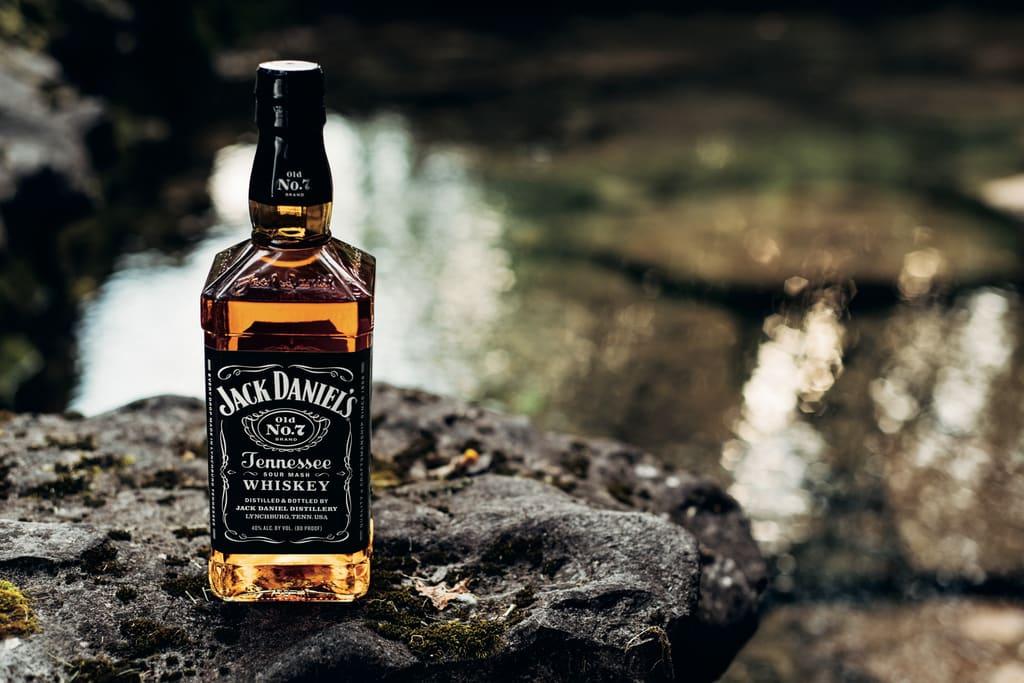 Bottle sitting on rock
