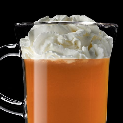 Warm Apple Pie Cocktail served with whipped cream