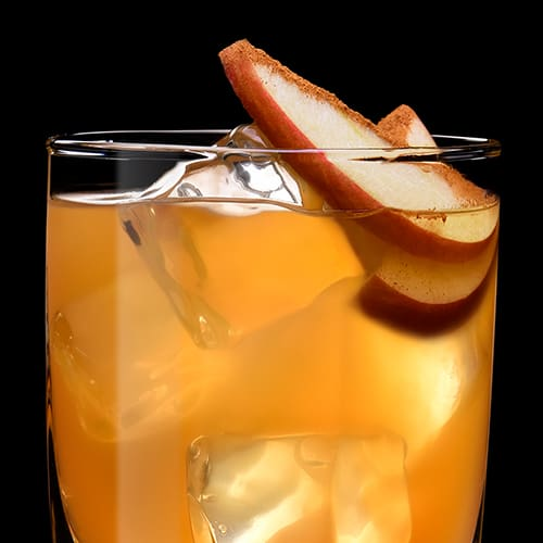 Cinnamon Smashed Apple Cocktail served with apple slice