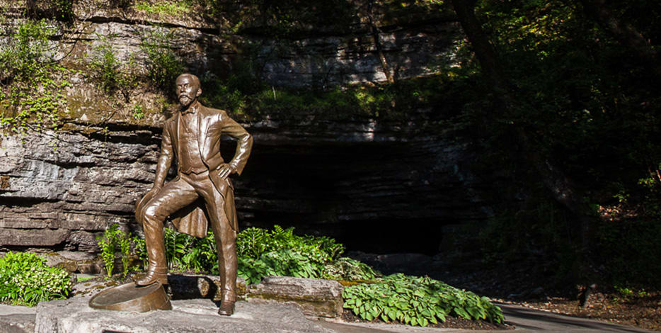 Jack Daniel's statue in front of cave spring