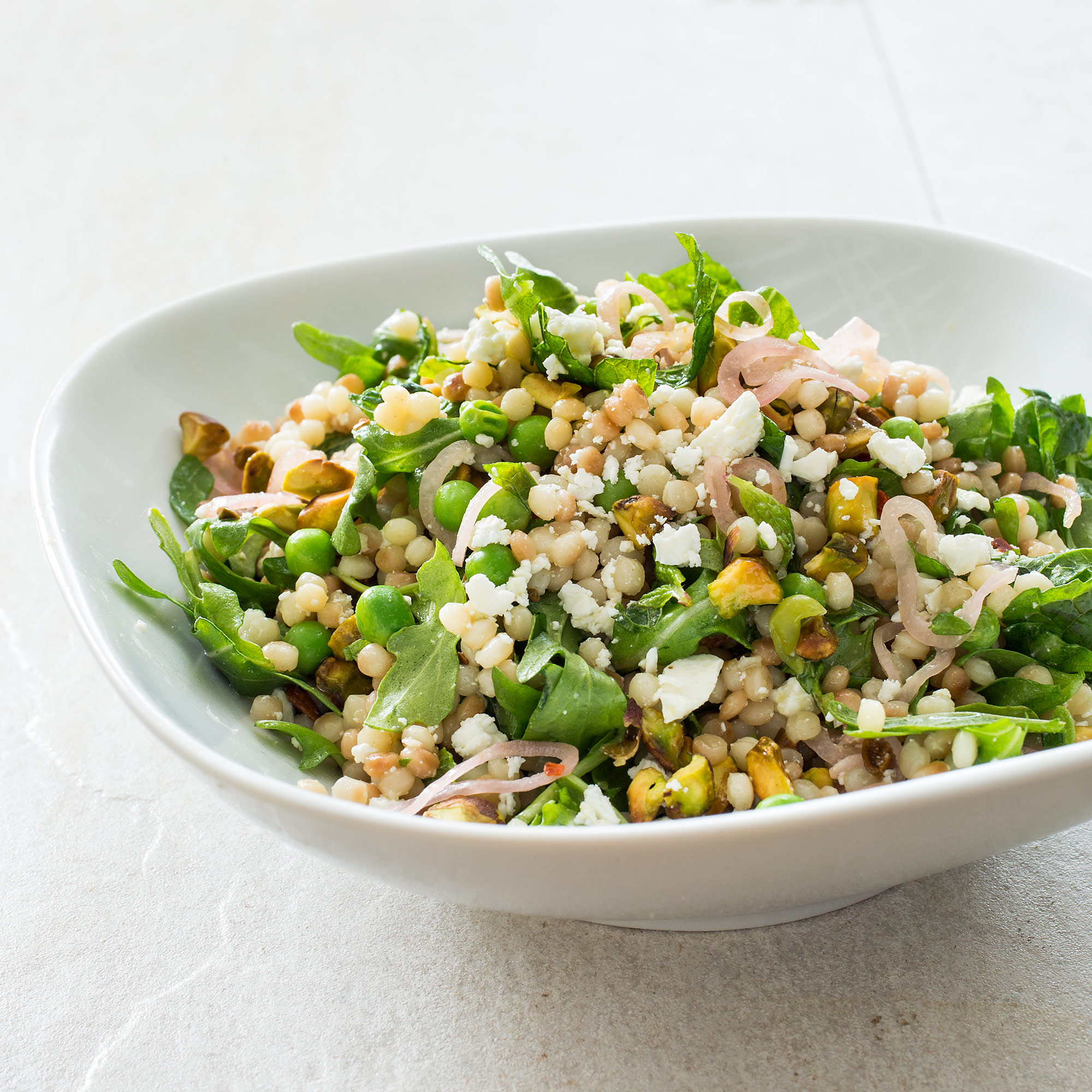 Israeli Couscous With Lemon Mint Peas Feta And Pickled Shallots Cook S Illustrated