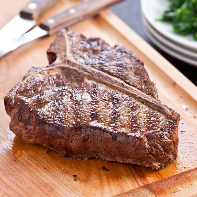 Grilled T-Bone Steaks with Lemon-Garlic Spinach
