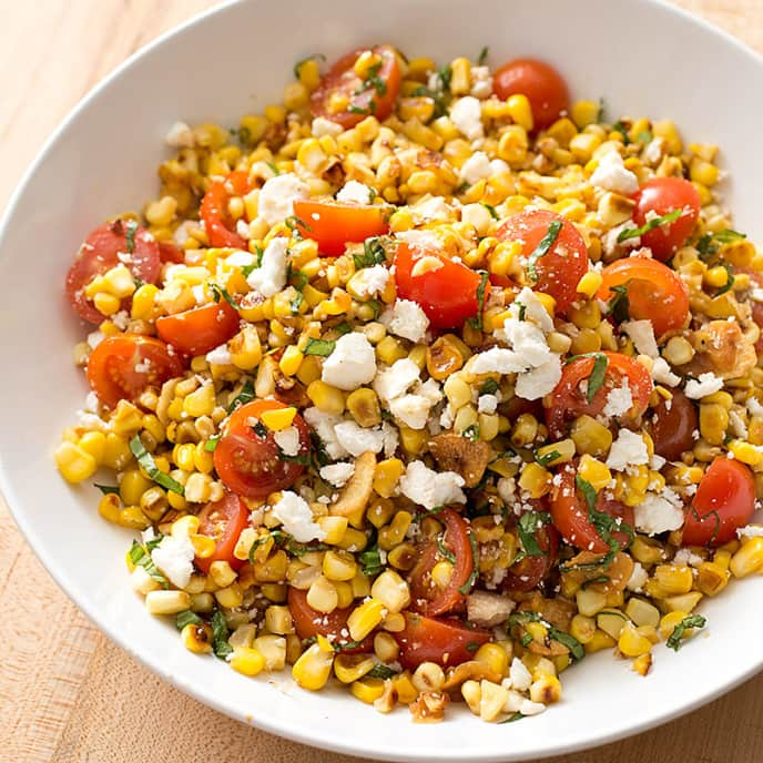 Sauteed Corn with Cherry Tomatoes, Ricotta Salata, and Basil