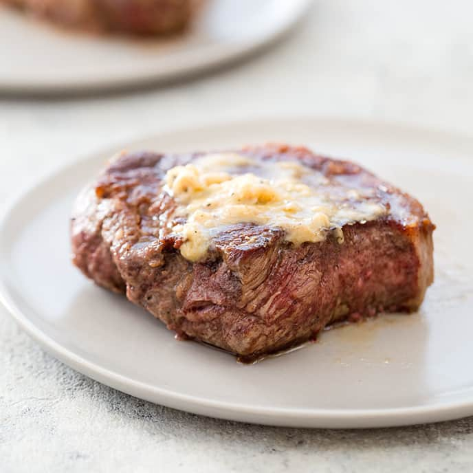 Strip Steaks with Herb-Horseradish Butter