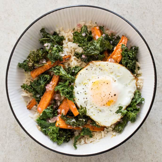 Gluten-Free Brown Rice Bowls with Roasted Carrots, Kale, and Fried Eggs