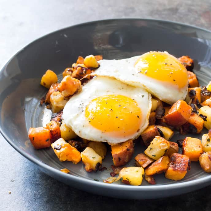 Paleo Sweet Potato and Celery Root Hash with Fried Eggs