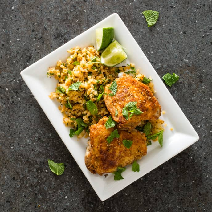 "Cumin-Crusted Chicken Thighs with Cauliflower ""Couscous"""