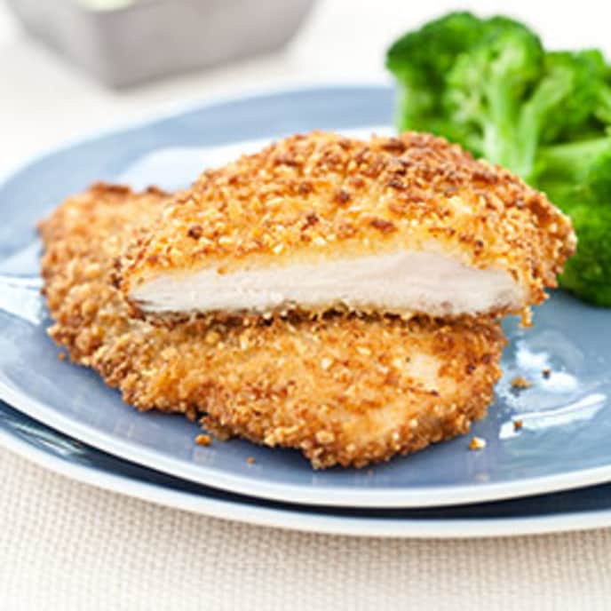 Macadamia Nut-Crusted Chicken Cutlets with Wilted Spinach- Pineapple Salad