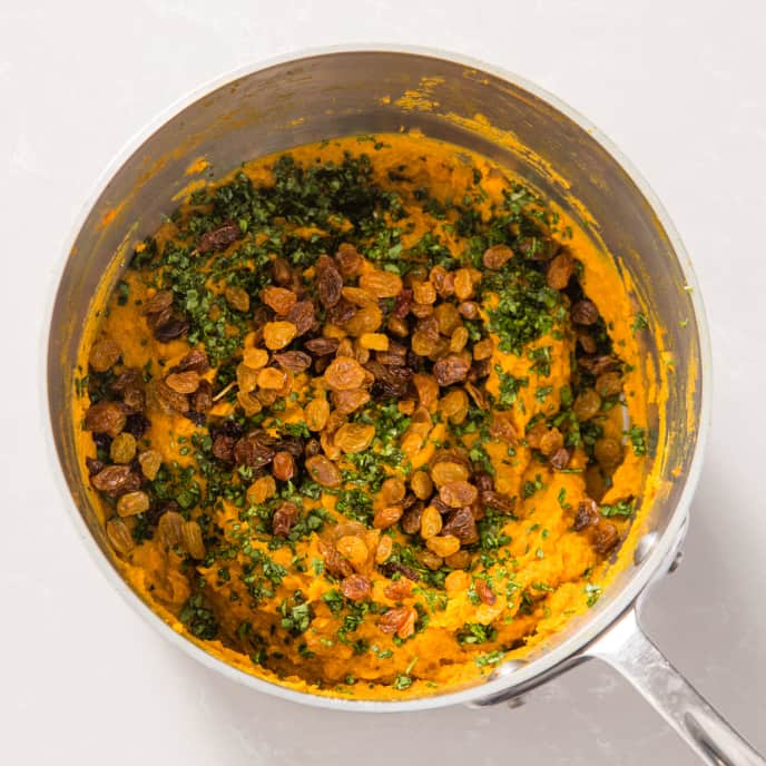 Mashed Sweet Potatoes with Curry and Golden Raisins