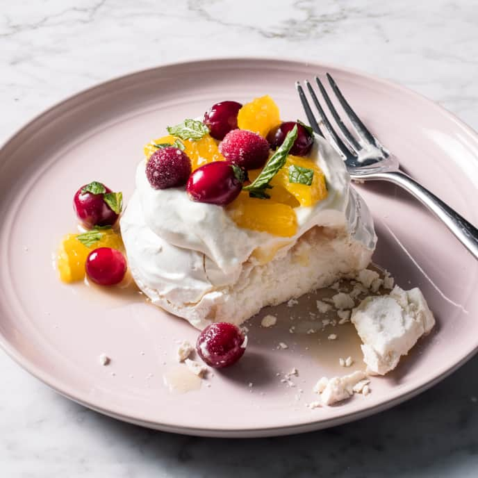 Individual Orange, Cranberry, and Mint Pavlovas with Whipped Cream