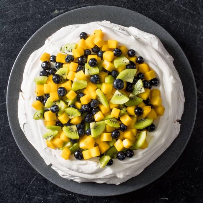 Mango, Kiwi, and Blueberry Pavlova with Whipped Cream