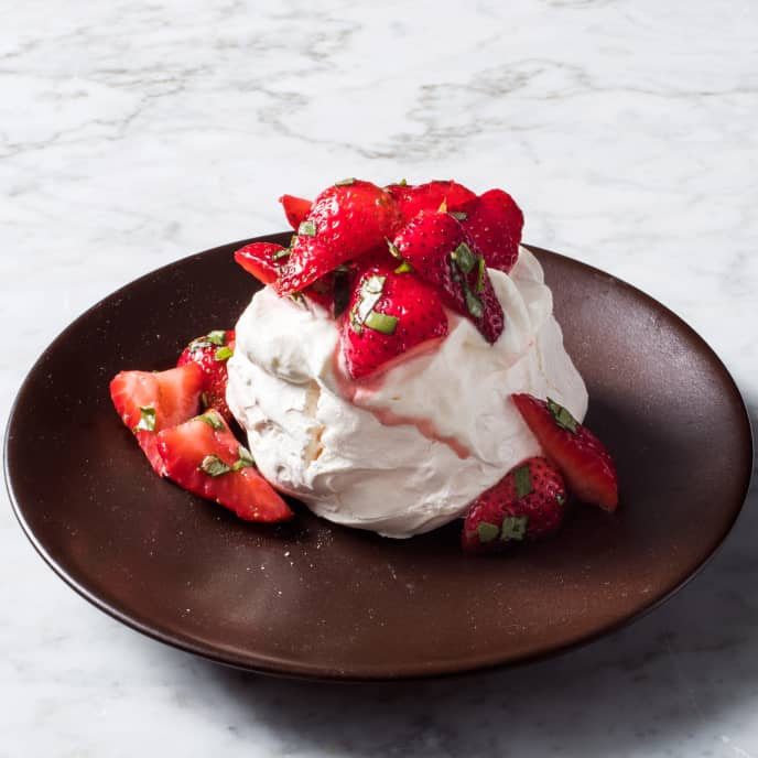 Individual Strawberry, Lime, and Basil Pavlovas with Whipped Cream