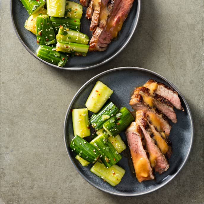 Grilled Strip Steaks with Smashed Cucumber Salad