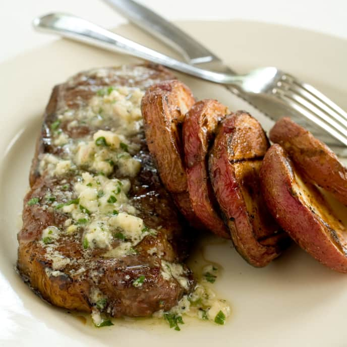 Charcoal-Grilled Strip Steaks and Potatoes with Blue Cheese Butter