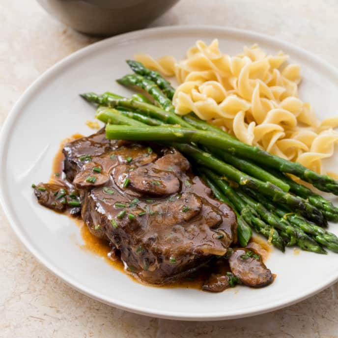 One-Pot Braised Blade Steaks with Mushrooms, Vidalias, and Steamed Asparagus