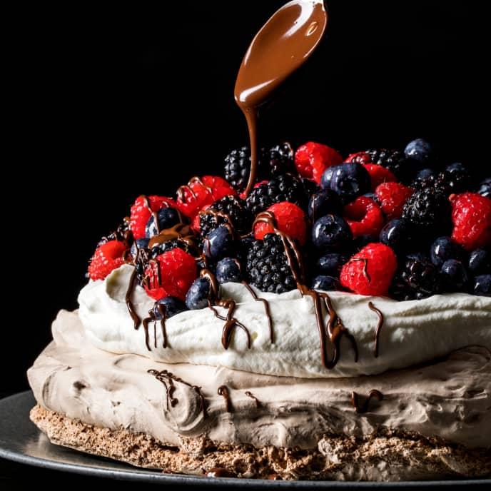 Chocolate Pavlova with Berries and Whipped Cream
