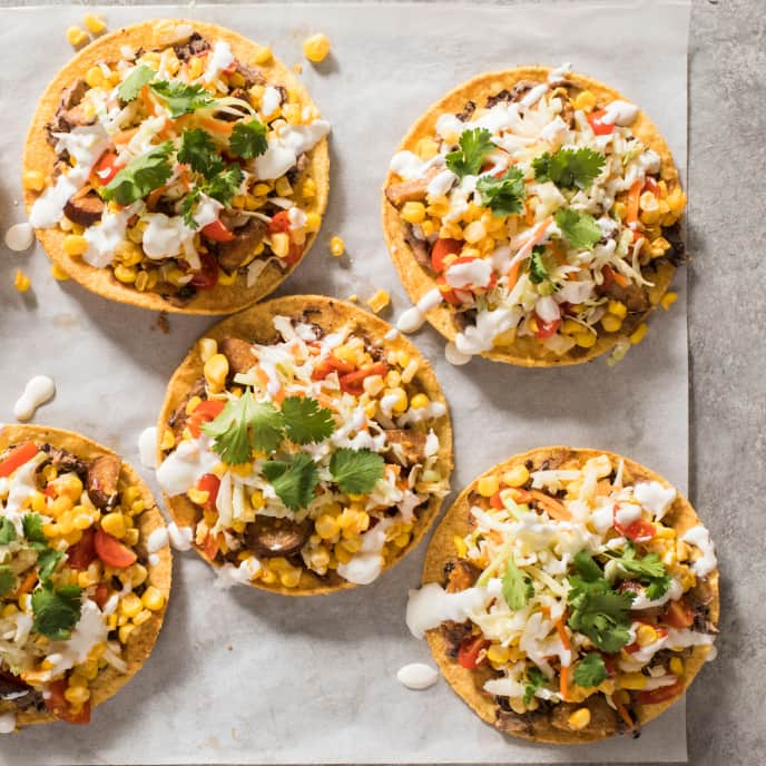 Sheet-Pan Chorizo, Corn, and Tomato Tostadas with Lime Crema