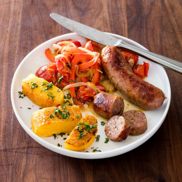 Sheet-Pan Italian Sausage with Peppers, Onions, Tomatoes, and Polenta