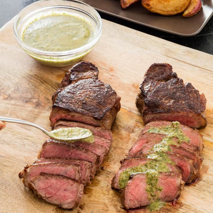 New York Strip Steaks with Crispy Potatoes and Parsley Sauce