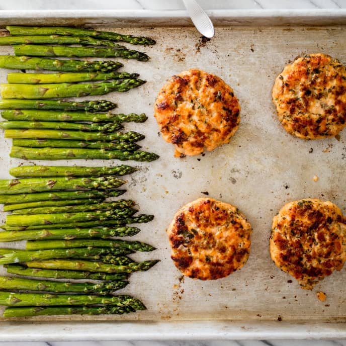Sheet-Pan Herbed Salmon Cakes with Asparagus and Lemon-Herb Sauce