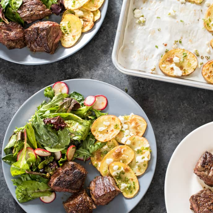 Skillet Steak Tips with Cheesy Roasted Potatoes and Mesclun Salad