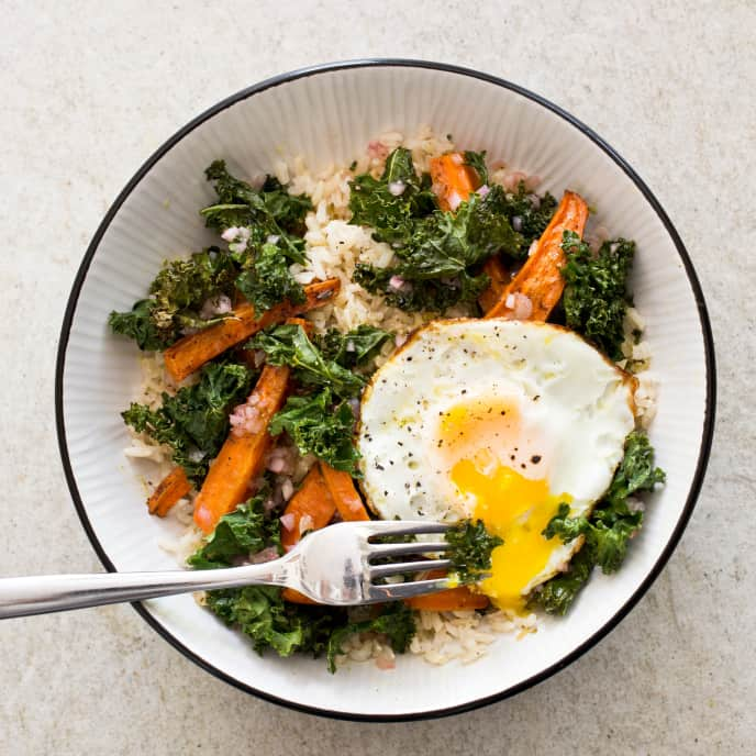 Brown Rice Bowl with Roasted Carrots, Kale, and Fried Eggs