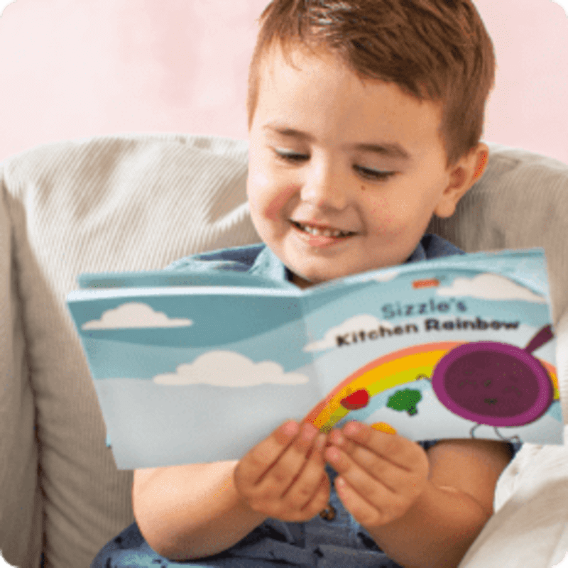 smiling boy reading a book
