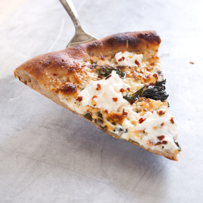 Thin-Crust Whole-Wheat Pizza with Garlic Oil, Three Cheeses, and Basil