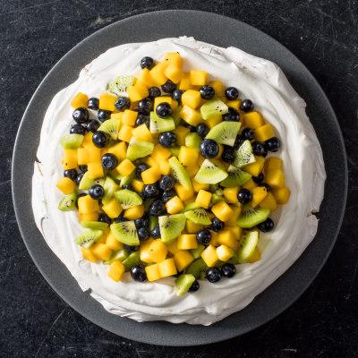 Individual Mango, Kiwi, and Blueberry Pavlovas with Whipped Cream