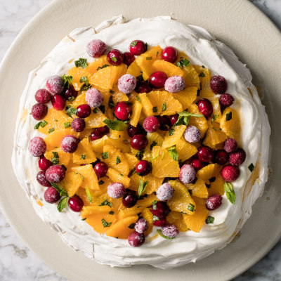 Orange, Cranberry, and Mint Pavlova with Whipped Cream