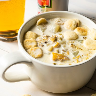 cup of clam chowder topped with oyster crackers