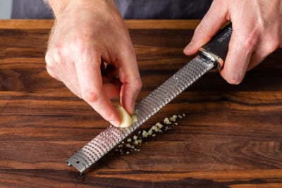 grating garlic with rasp grater