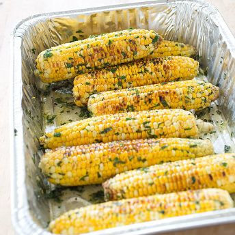 Grilled Corn with Flavored Butter | America\'s Test Kitchen