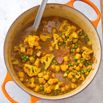 Indian style curry with potatoes cauliflower peas and chickpeas ingredients forumfinder Image collections