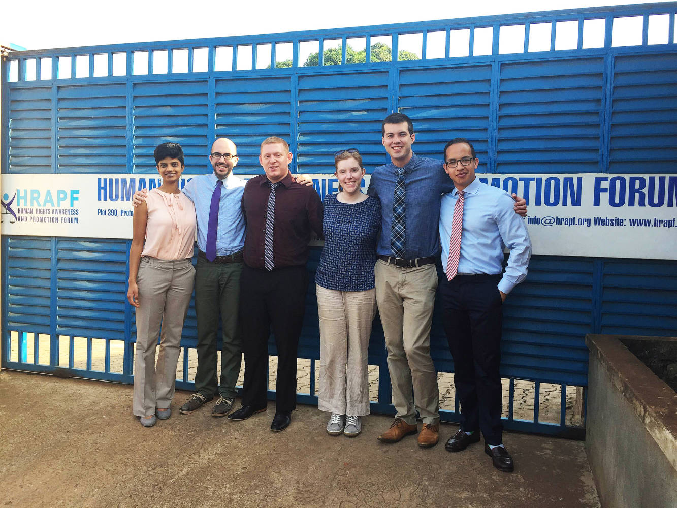 L-R: Maithreyi Nandagopalan '18, Charles Fletcher '18, Brandon Storm '18, Anna Crowe, Clinical Fellow in the International Human Rights Clinic, Brian Klosterboer '16, and Andres Caicedo '16 stand for photo at the Human Rights Awareness and Promotion Forum (HRAPF) in Uganda