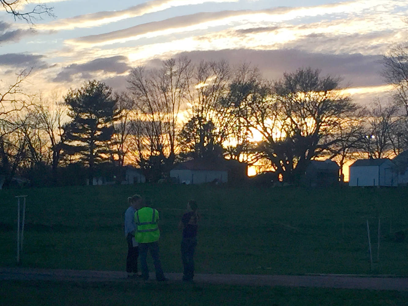 HLS students Lark Turner '18 and Ryan Cohen '17 outside on a field as the sun sets