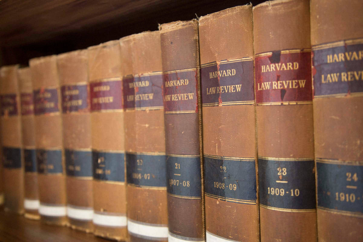 Closeup of Harvard Law Review books on bookshelf (1902-1911)