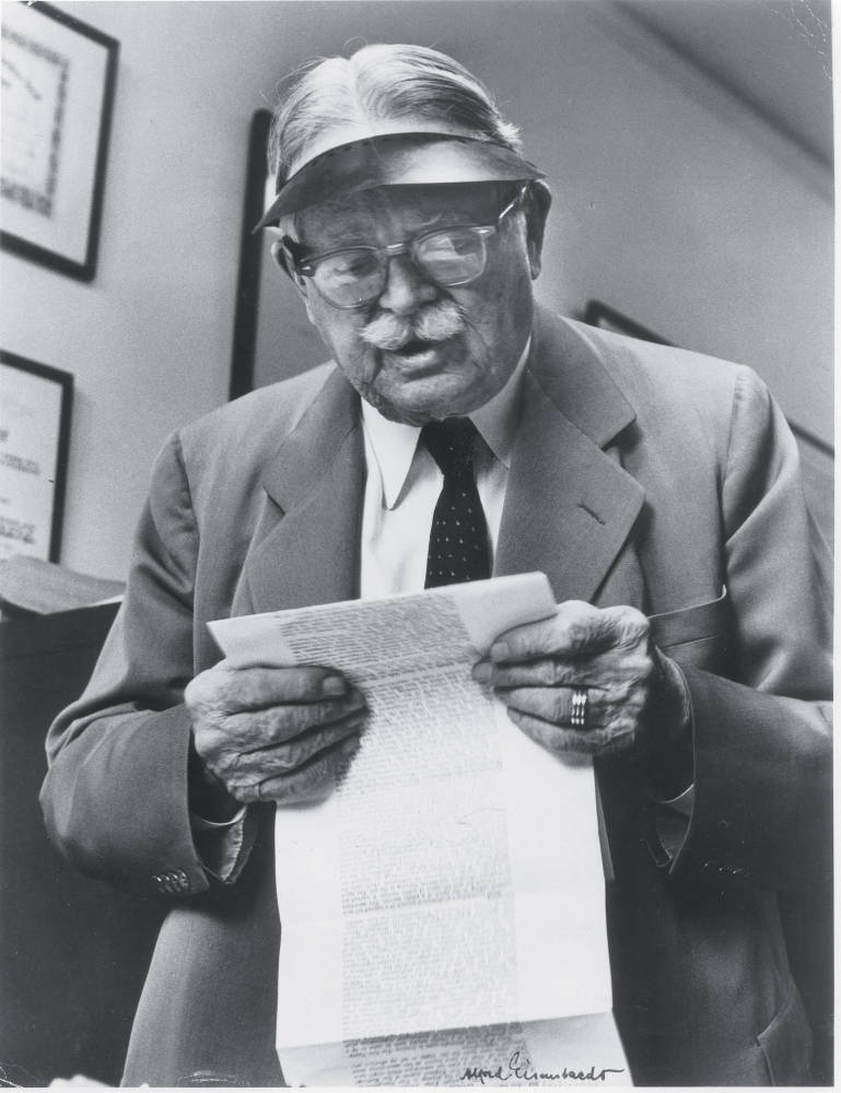 Roscoe Pound reading a letter