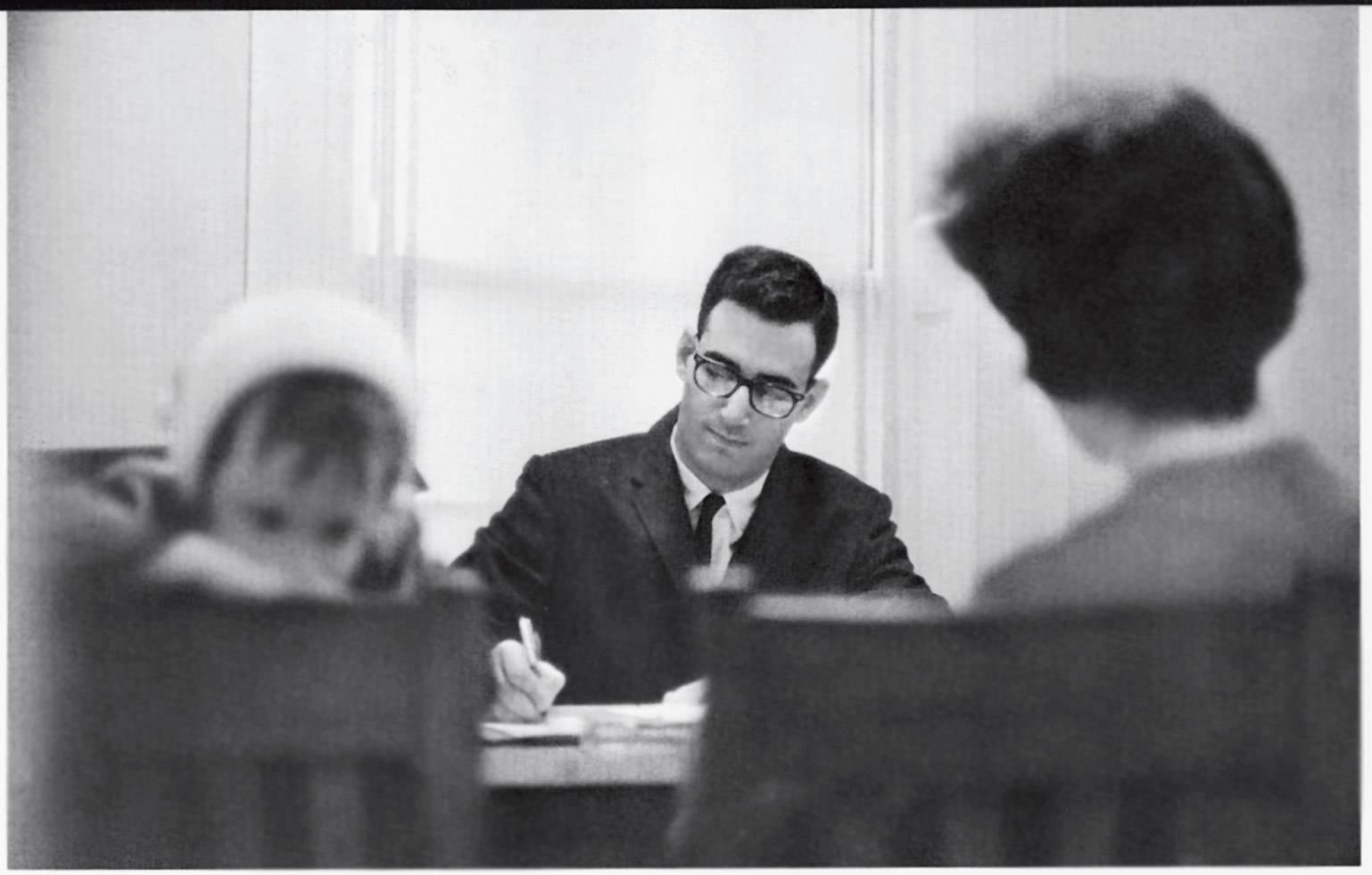 Earl Leiken '67 meets with a client in 1966