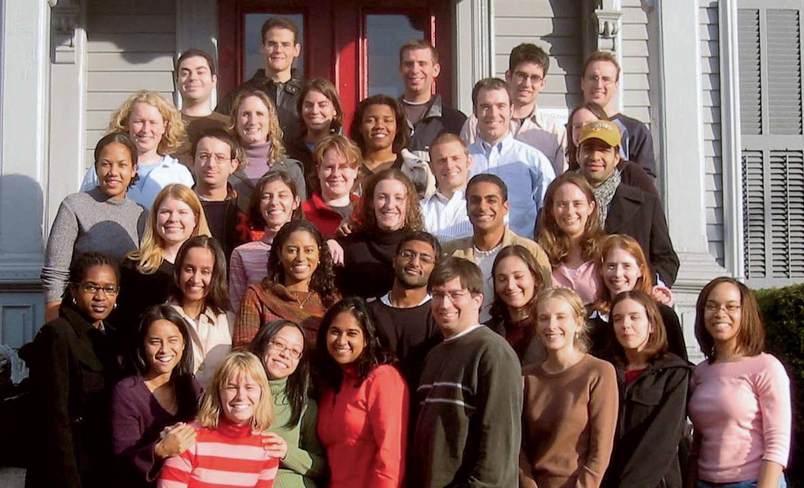 Group photo of Harvard Legal Aid Bureau on the steps of their 1587 Massachusetts Ave. office