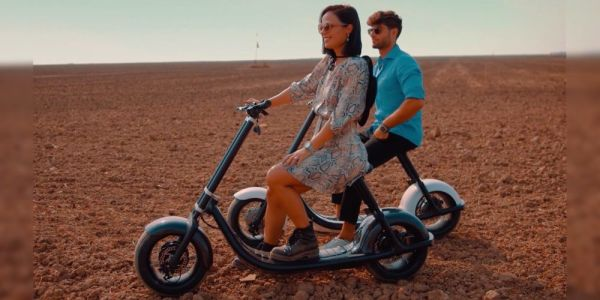 This giant-wheeled electric scooter makes some bold self-driving claims