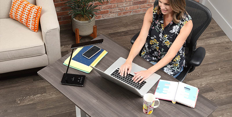 Woman Sitting and working at SmartMoves Adjustable Height Desk