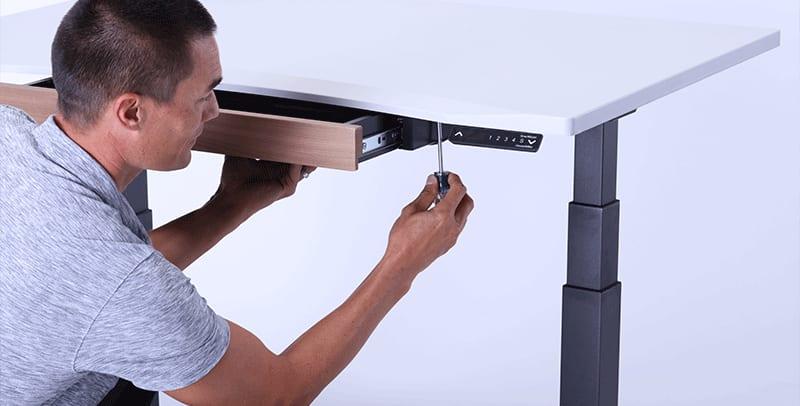Man Assembling SmartMoves Adjustable Height Desk