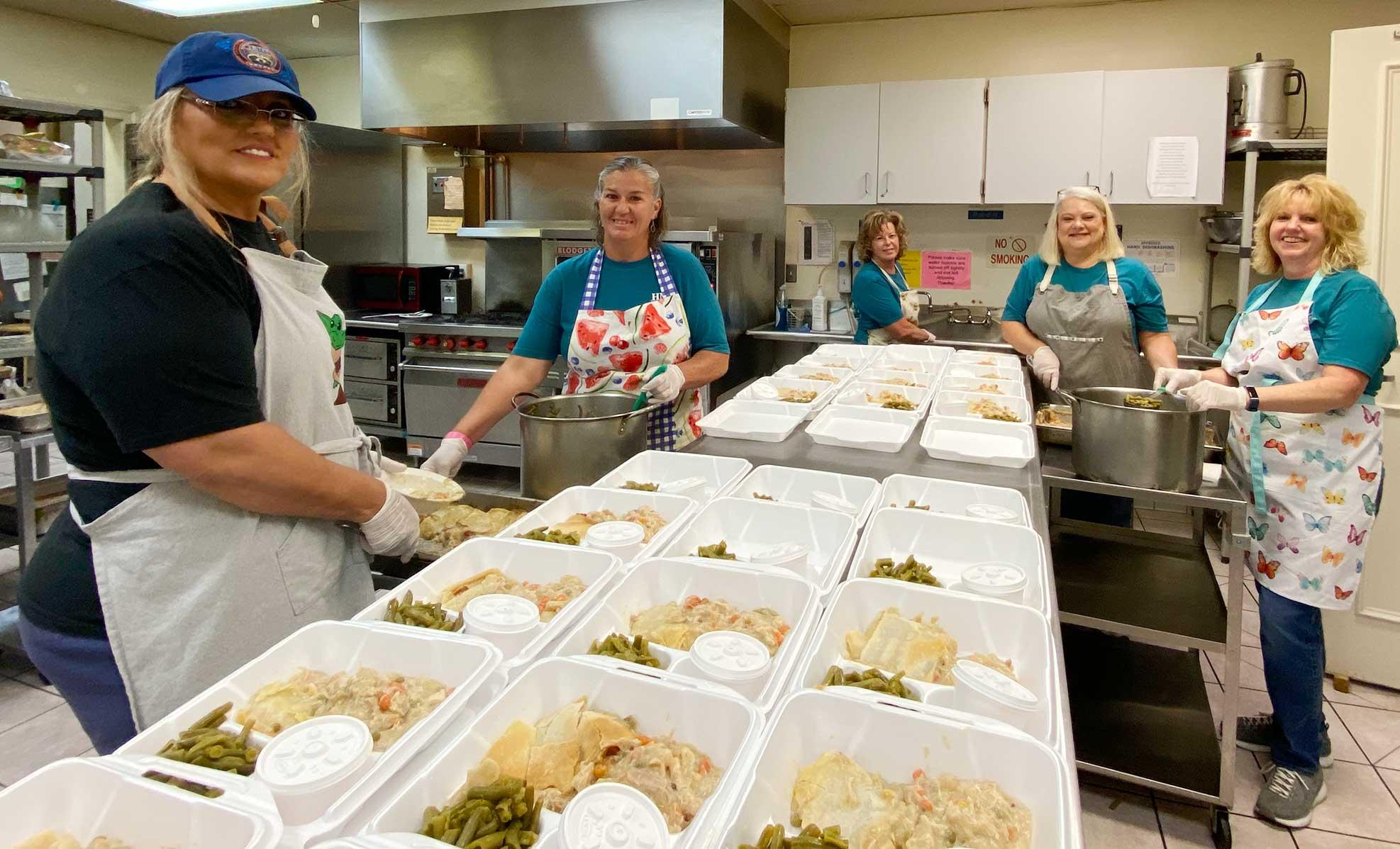 volunteers preparing meals