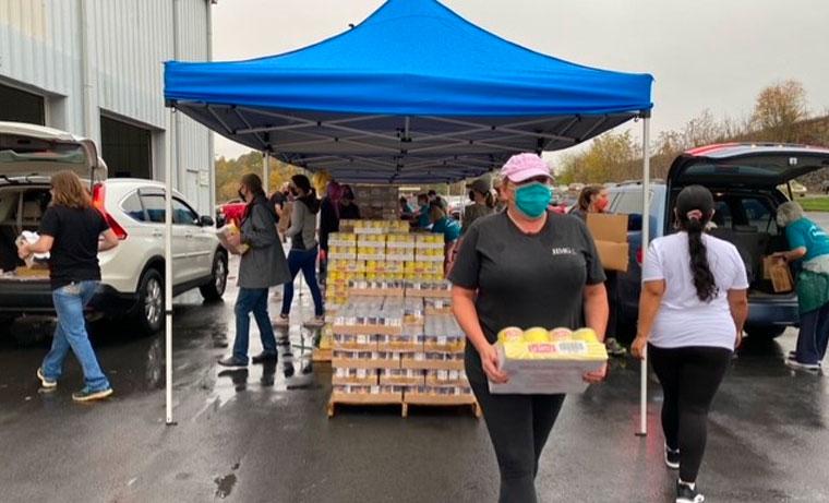 Harvest Food Bank & HMG transporting food
